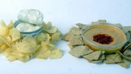 Instead of using French onion dip, seen here on the left in the studio, a healthy alternative could be eating hummus. Hummus is more natural with less ingredients and more protein, and it's a natural source of fiber. (Jason Plotkin - Daily Record/Sunday News)