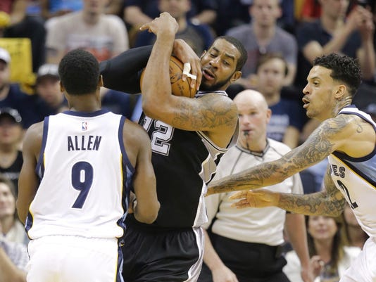 San Antonio Spurs forward LaMarcus Aldridge (12) grabs a rebound between Memphis Grizzlies' Tony Allen (9) and Matt Barnes, right, in the first half of Game 3 of a first-round NBA basketball playoff series Friday, April 22, 2016, in Memphis, Tenn. (AP Photo/Mark Humphrey)