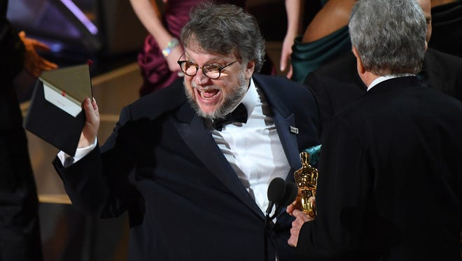 "March 4, 2018; Hollywood, CA, USA; Guillermo del Toro and J. Miles Dale accept the Oscar for best motion picture of the year for  ""The Shape of Water"" during the 90th Academy Awards at Dolby Theatre."