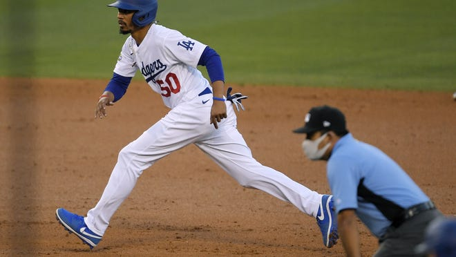 Dodgers outfielder Mookie Betts takes a lead off second during an intrasquad baseball game Thursday, July 16, 2020, in Los Angeles. Betts signed a 12 year, $365 million contract extension with Los Angeles on Wedenesday.