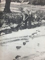 John Martin shoveled his sidewalk following the 8 inches of snow that fell in 1984.
