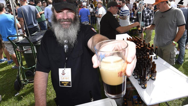 Rich Zielke of Shipwrecked Brew Pub in Egg Harbor pours a sample of its Java Porter last year at Egg Harbor AleFest. Shipwrecked will have three beers available at this year's AleFest, taking place Sept. 16, despite its building being totalled in an August fire.