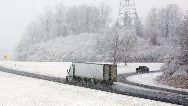A tractor trailer travels westbound on Interstate 84 in Southeast on Wednesday, Nov. 26, 2014.