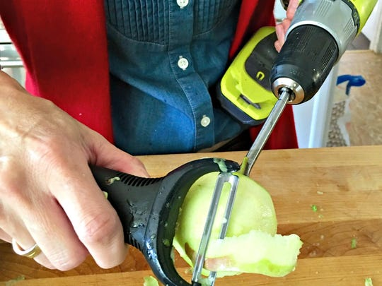 Using a drill and an apple peeler together make peeling an apple a cinch.