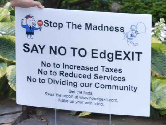 """""""Stop the Madness,"""" says the anti-incorporation sign"""