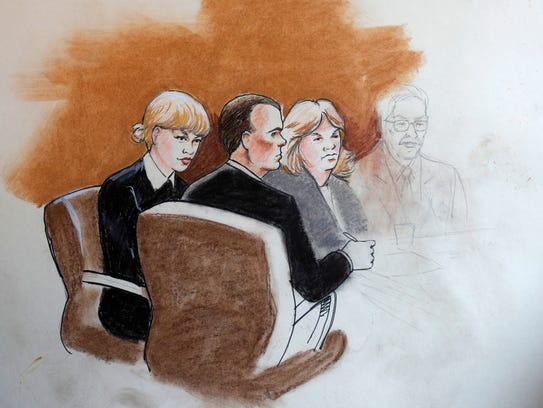 Courtroom sketch of Taylor Swift with her lawyer and