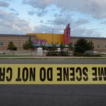 Crime scene tape surrounds the Century 16 movie theater where 12 people were killed in a shooting rampage last Friday, on July 23, 2012 in Aurora, Colorado. Suspect James Holmes, 24, allegedly went on a shooting spree and killed 12 people and injured 58 during an early morning screening of 'The Dark Knight Rises.'