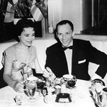 In this 1954 file photo, Frank Sinatra sits with recording artist Jill Corey at the Harwyn Club in New York. A couple of New York exhibits are paying homage to the centennial of Frank Sinatra's birth by displaying rare photographs and mementos, many of them from the family archive.