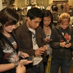 Teen shoppers at the Westfield San Francisco Centre respond to an in-store promotion by texting in on their cellphones