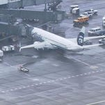 Alaska Airlines jet lands after worker naps, wakes in cargo