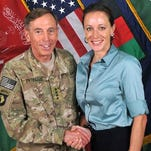 """Then-Gen. David Petraeus, left, shakes hands with Paula Broadwell, co-author of """"All In: The Education of General David Petraeus"""" in a photo made available in July 2011 on the International Security Assistance Force's Flickr website."""