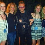 The Lawton family (including Lizzy, far right), poses with U2 lead singer Bono at Saturday's concert.