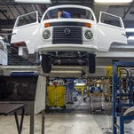 A person works on the production line of the Volkswagen Kombi minibus on December 9, 2013 in Sao Bernardo do Campo, Brazil. The German automaker ceases production of the iconic vehicle on December 20, 2013. The Kombi was produced in Brazil for 56 years.