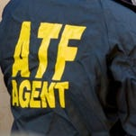 ATF agent at work in 2001. Federal, state and local authorities joined forces on Wednesday, Sept. 2, 2015, in a crackdown on a heroin-trafficking ring on Indianapolis' Westside. Police arrested 11 people, 19 firearms, $160,000 in cash and heroin and meth in the bust.