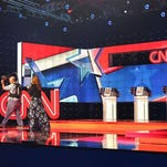Workers walk on the stage a day before the CNN Facebook Democratic Debate at the Wynn Las Vegas on October 12, 2015 in Las Vegas.