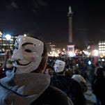 """Protesters take part in the """"Million Mask"""" demonstration in London on Nov. 5, 2014."""