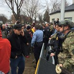 Minneapolis police set up a barricade outside the city's Fourth Precinct.