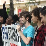 A group of Florida State students rally Tuesday in support of events at the University of Missouri, where protests of racism have resulted in the university president resigning and spurred cries of discrimination and lack of minority enrollments at college campuses throughout the nation.