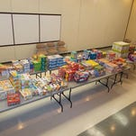 LESA officials begin to sort snacks years back for their annual Snack Pack Drive, which will start Nov. 30 through Dec. 14.