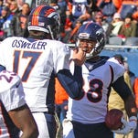 Nov 22, 2015; Chicago, IL, USA; Denver Broncos wide receiver Demaryius Thomas (88) is congratulated for scoring a 48 yard touchdown reception by quarterback Brock Osweiler (17) during the first quarter against the Chicago Bears at Soldier Field.