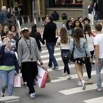 Shoppers cross a street Sunday, Nov. 22, 2015, in San Francisco.