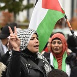 Pro-Palestinian protesters gather outside the Chancellery in Berlin prior to the arrival of Israeli premier Benjamin Netanyahu on Oct. 21, 2015.
