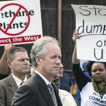 Mayor Greg Fischer faced protesters against the methane plant proposal at a press conference last fall.