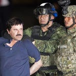 """Joaquin """"El Chapo"""" Guzman faces the press as he is escorted to a helicopter in handcuffs by Mexican soldiers and marines at a federal hangar in Mexico City, Mexico, Friday, Jan. 8, 2016."""