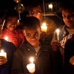 Mourners attend a vigil in memory of Nathaniel Plummer Jr., a Camden youth slain Thursday.