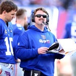 The Giants were reportedly set to promote Ben McAdoo, right, from offensive coordinator to head coach. The Eagles had also interviewed McAdoo.