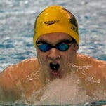 Howell's Sam Timmerman won three of the events he participated in as the Highlanders defeated Hartland on Friday night.