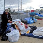 Tent city dwellers with their belongings at the current homeless shelter in Reno.