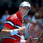 John Isner celebrates after defeating Feliciano Lopez in their third-round match at the Australian Open.