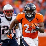 DENVER, CO - JANUARY 24: C.J. Anderson #22 of the Denver Broncos runs with the ball in the second half against the New England Patriots in the AFC Championship game at Sports Authority Field at Mile High on January 24, 2016 in Denver, Colorado.