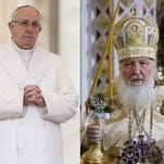 In this file photo combination Russian Orthodox Patriarch Kirill, right, serves the Christmas Mass in the Christ the Savior Cathedral in Moscow, Russia, on , Jan. 7, 2016 and Pope Francis prays during an audience at the Vatican on Jan. 30, 2016.
