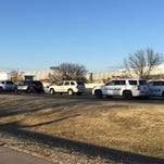 In this photo provided by KWCH-TV, police vehicles line the road after reports of a shooting at an industrial site in Hesston, Kan. on Thursday.