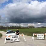 A Piketon police officer mans the barricades on one end of Union Hill Road.