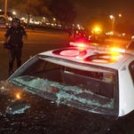A damaged Costa Mesa Police cruiser sits at the corner of Fair Dr. and Fairview Rd. near the OC Fairgrounds where Donald Trump spoke earlier in Costa Mesa, Calif., April 28, 2016