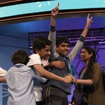 Nihar Janga, 11, of Austin, Texas, and Jairam Hathwar, 13, of Painted Post, N.Y., celebrate as co-champions with their families during the 2016 Scripps National Spelling Bee at the Gaylord National Resort and Convention Center.