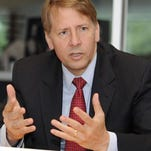 Richard Cordray, head of the Financial Consumer Protection Bureau, speaking in 2013.