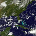 This satellite photo taken August 25 shows storm activity in the Atlantic.