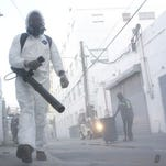 Municipal workers clean the streets in Miami Beach to control the spread of mosquitoes. Local authorities are taking steps to prevent an outbreak of Zika in the city while they are waiting to confirm Miami Beach as the new zone of the virus transmission.