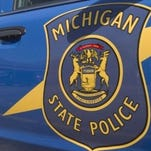 Police: Woman dies after her vehicle struck by stolen car