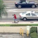 Man runs away from police using a skateboard