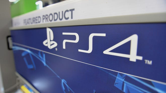 A Sony PlayStation 4 console display is viewed in a Best Buy store in Manhattan, in New York.