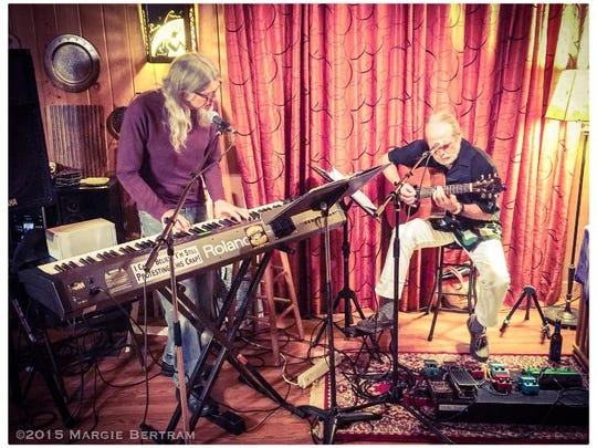 Mike Rychlik and guitarist Warren Sutton weave words and melodies at Blue Tavern Friday.