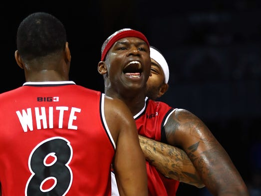 Al Harrington of Trilogy reacts at the end of the game