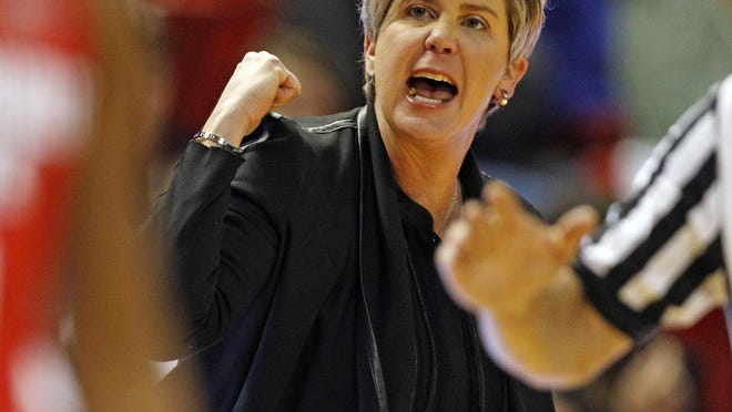 Texas Tech women's basketballl coach Marlene Stollings cheers after a three-point shot during a nonconference game Friday against Jacksonville State at United Supermarkets Arena. The Lady Raiders defeated the Gamecocks 71-58.