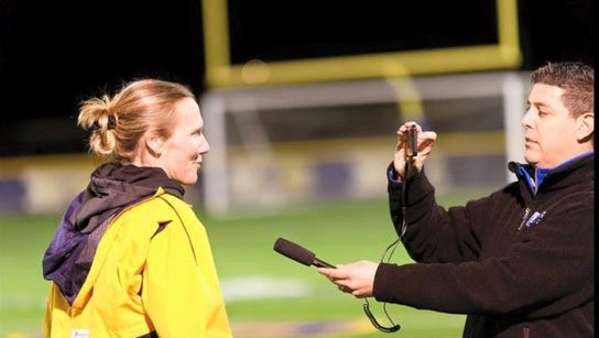 Interviewing Victor soccer coach Kelly Ahern, whom