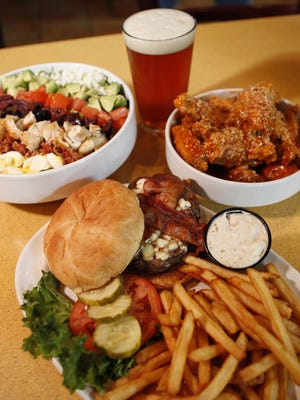 A chopped Cobb salad, garlic Parmesan wings and a black- and-bleu bacon burger are a few of the items on the Buffalo Wings & Rings menu.